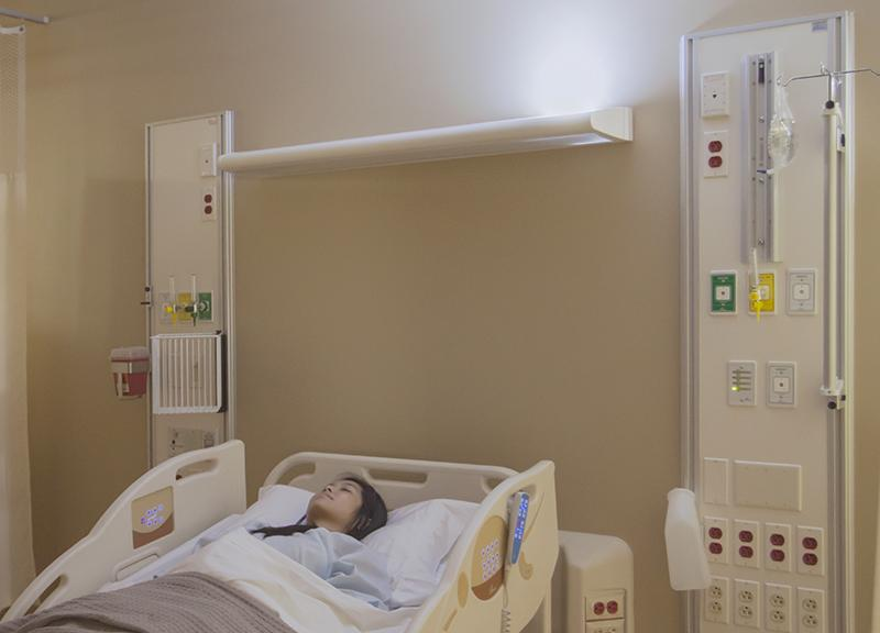 Upon Any Movement Of The Light Fixture From Mounting Bracket Bed Stop Feature Temporarily Shuts To Electrical Outlet That Patient